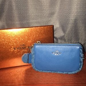 Small blue coach clutch